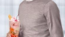 Roger Federer holding a Knickerbocker Glory